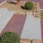 Granitblockstufen mit Podest aus Pflasterklinker
